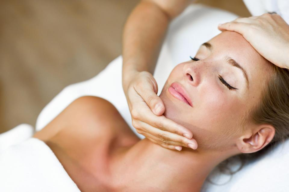 young-woman-receiving-head-massage-spa-center.jpg